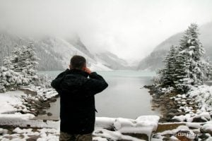 man taking photo in winter